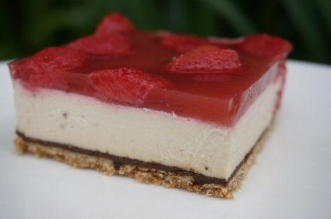 Gluten free base, carob chocoloate layer, almond cream filling, berry jelly topping (set with agar.)