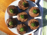 Individual serves of carob mud cake with coconut cream/carob ganache.
