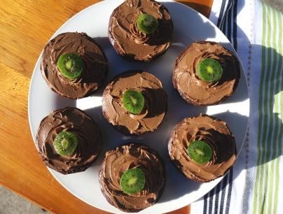 Individual serves of carob mud cake with coconut cream/carob ganache.