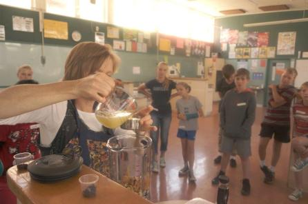 Measuring half a cup of lemon juice for a raw lemon cheesecake. Location: Freyberg High School Food & Nutrition Room (holiday cooking workshop)