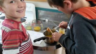 Carefully measuring just two tablespoons of honey - the only sweetening in the whole cake!