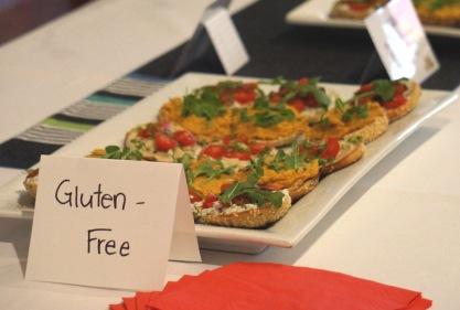 Gluten free rolls topped with pumpkin hummus, vegan cream cheese and sundried tomato & walnut pesto