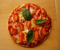 Delicious pizza base made from mashed potato, baked in the stone oven.